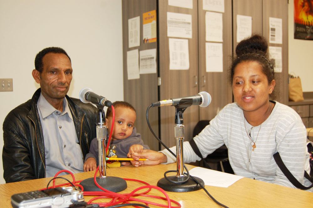 Parents and students recording interviews at a World School Literacy Night (Bill Butler)