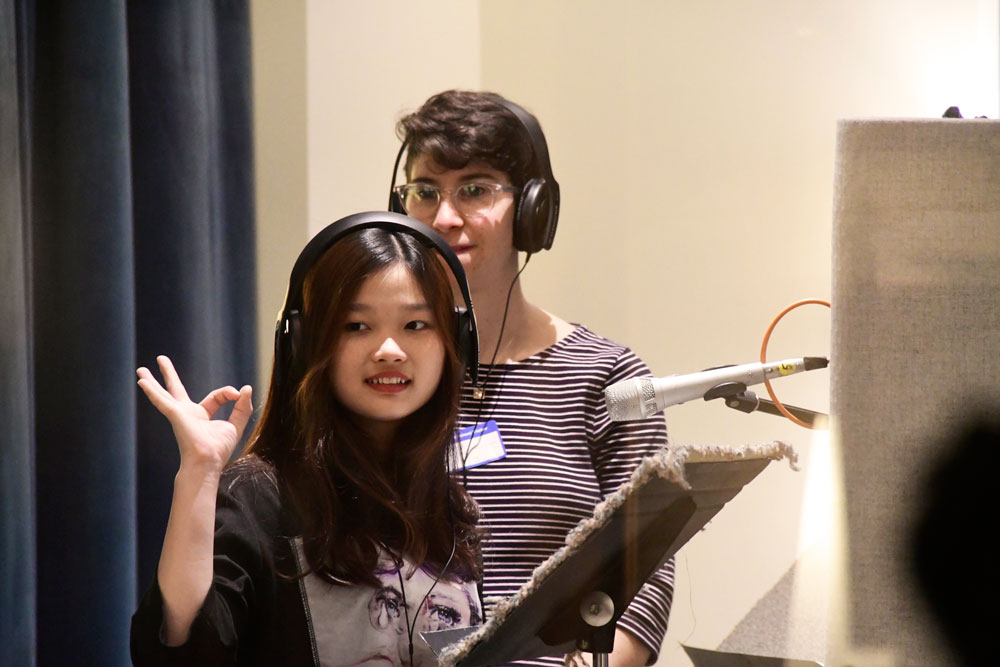A student records her Sounds from Home piece in the Jack Straw studio with voice coach Katya Landau.