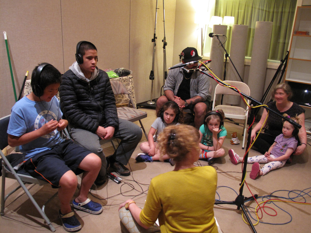 Erin Elyse Burns and participants create sound effects in the studio