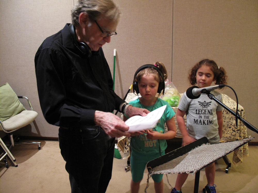 Jesse Minkert and two students recording their voices in the studio